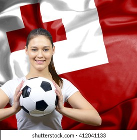 Proud woman football fan of Tonga