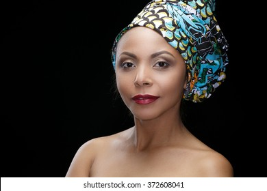 Proud woman. Studio shot of a cheerful beautiful African mature female posing against black background
