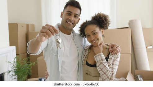 Proud young African American couple with keys