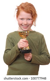 Proud young girl holding her trophy on white background