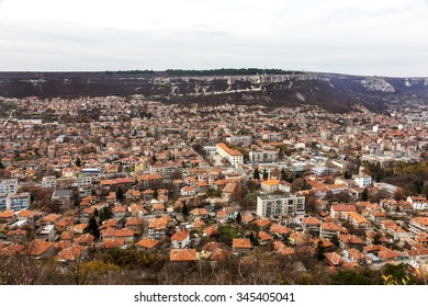 Provadia, Bulgaria - 19 November 2015: The ancient city is located in a mountain valley at the foot of mountain to the ancient temple fortress Ovech. The economic crisis can be seen as tiled rooftops.