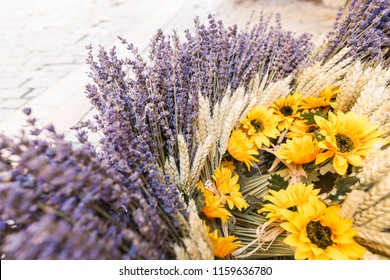 A provencal basket with lavender, wheat and sun flowers in Apt, Provence