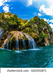 Provence Alps, France. Charming little waterfall on the limestone wall of the Verdon Gorge. The journey through the water. Concept of ecological and active tourism