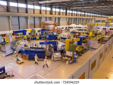 PROVENCE, FRANCE - JULY 31, 2017: Workers in the ITER PF Coils Winding facility building, ITER, International Fusion Energy Organization.