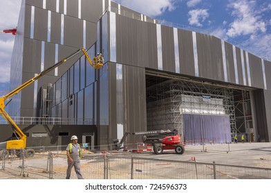 PROVENCE, FRANCE - JULY 31, 2017: Worker and lift at Tokamak Assembly Hall under construction,  ITER, International Fusion Energy Organization.