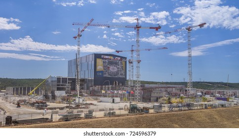 PROVENCE, FRANCE - JULY 31, 2017: Site overview of ITER, with Assembly Building, center, and construction cranes, International Fusion Energy Organization.