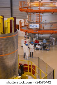 PROVENCE, FRANCE - JULY 31, 2017: ITER PF Coils Winding facility building, ITER, International Fusion Energy Organization. Workers near Alsyom vacuum chamber.