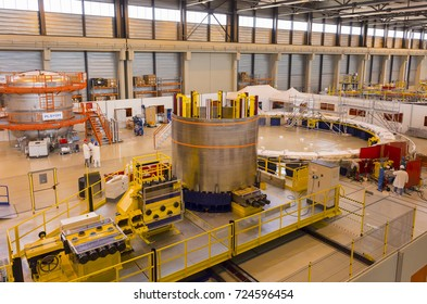PROVENCE, FRANCE - JULY 31, 2017: ITER PF Coils Winding facility building, ITER, International Fusion Energy Organization. Conductor spool, center.