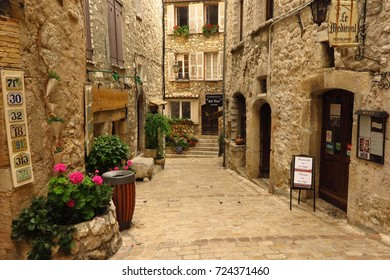 PROVENCE, FRANCE – JUNE 13, 2017: Shops and restaurants line a picturesque narrow street in the medieval Provencal village of Tourrettes-sur-Loup.
