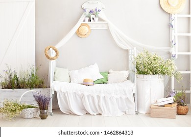 Provence, rustic style, Lavender ! country white bedroom with wooden floor in retro style. Shabby chic interior girly in the Provencal style.  Village, farmhouse. Flowers in the interior of the house.
