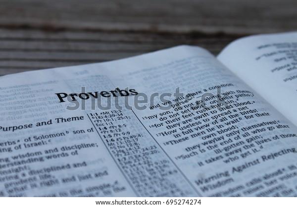 Proverbs English Spanish Stock Photo (Edit Now) 695274274