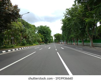 To provide restrictions on community movement so that they can reduce the spread of the Corona virus. Surabaya Polrestabes closed Jalan Darmo. Surabaya, Indonesia, January 2021.