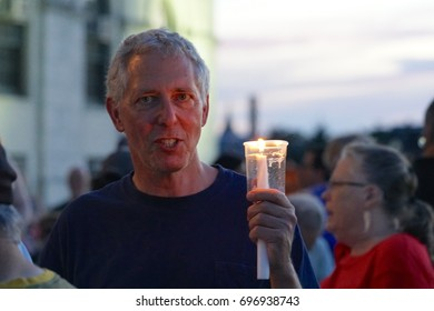 PROVIDENCE, RHODE ISLAND, USA - AUGUST 13, 2017: A Vigil for Charlottesville, organized by Ashley Hayes, occurred at The Rhode Island State House in Providence, Rhode Island on August 13, 2017.