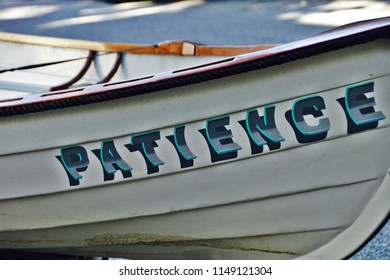 """Providence, Rhode Island/USA- October 6, 2016: A horizontal image of the wooden skiff, """"Patience,"""" dry-docked in an urban yard."""