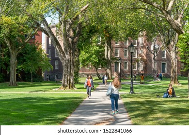 PROVIDENCE, RI/USA - SEPTEMBER 30, 2019:   Unidentfied individuals, and University Hall  on the campus of Brown University.