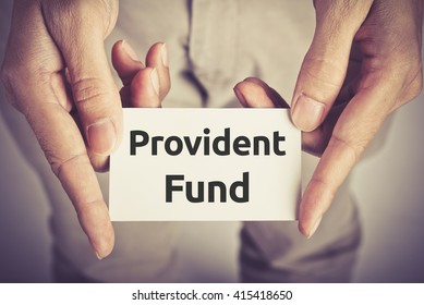 """ Provident Fund "" word on card hold by man"
