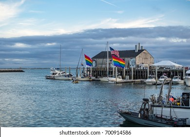 Provincetown, MA, USA - August 10 2017: Boats and a decorated house in the Provincetown Marina.