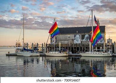 Provincetown, MA, USA - August 12 2017: Boats and a decorated house in the Provincetown Marina.