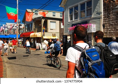Provincetown, MA, USA July 5, 2009 A summer crowd walks on Commercial Street, the main street in downtown Provincetown, Massachusetts