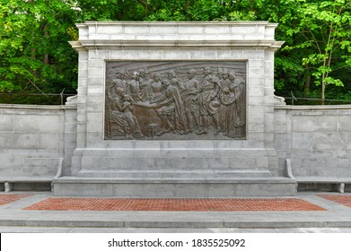 Provincetown, Massachusetts - July 4, 2020: Pilgrim's Monument and Bronze Bas Relief in Provincetown, Massachusetts, USA.