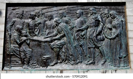 Provincetown, Massachusetts - September 6, 2009:  Bas relief panel on base of the Pilgrim Monument depicts Pilgrims signing the Mayflower Compact in 1620