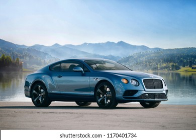 Provincia di Reggio Calabria, IT - SEP 01, 2018: Bentley Continental GT near lake and mountain