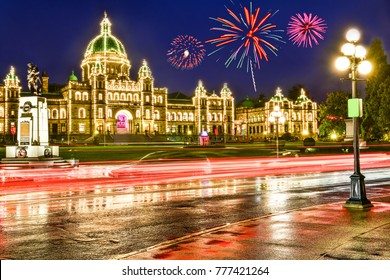 Provincial Parliament in Victoria at night time with firework ,British Columbia,Canada