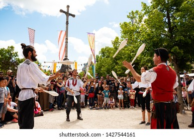 PROVINS, FRANCE - JUNE 16, 2019: Street artists juggling with skittles before the public during the traditional Medieval festival. Medieval town of Provins is UNESCO World Heritage Site.