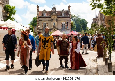PROVINS, FRANCE - JUNE 16, 2019: People in medieval costumes (knights, nobles etc) walking at streets during the traditional Medieval festival. Medieval town of Provins is UNESCO World Heritage Site.