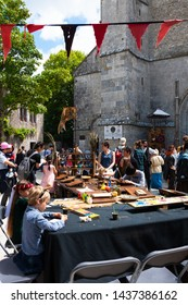 PROVINS, FRANCE - JUNE 16, 2019: Children participate at painting workshop during a traditional Medieval festival. Medieval town of Provins is UNESCO World Heritage Site. Culture fun learning concept