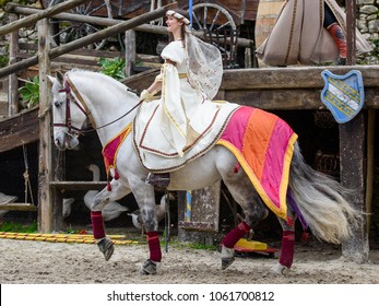 PROVINS, FRANCE - MARCH 31, 2018: Unidentified beautiful girl in white dress of princess rides on a horse  in the medieval reconstruction of Legend of the Knights