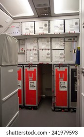 Provision cabinetss on the airplane. Food in box for passengers on the plane. Storage space on the aircraft with trolleys with lunch.