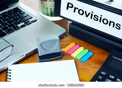 Provisions - Office Folder on Office Desktop with Office Supplies. Business Concept on Toned and Blurred Background