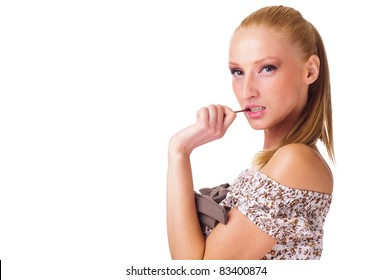 Provocative young woman holding lollipop