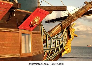 Prow of Old Ship. Modern ship at sea horizon.