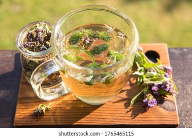 Prunella vulgaris (known as common self-heal, heal-all, woundwort, heart-of-the-earth, carpenter's herb, brownwort and blue curls herbal tea with dry and fresh herb.