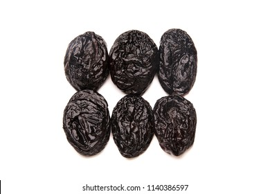 Prunes arranged in two rows isolated on a white background
