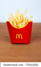 Pruszcz Gdanski, Poland - December 15, 2017: McDonald's potato french fries in the red box on wooden background.