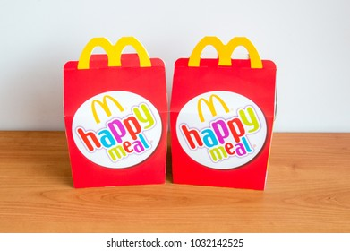 Pruszcz Gdanski, Poland - February 22, 2018: McDonald's happy meal's boxes on wooden table.