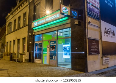 Pruszcz Gdanski, Poland - January 22, 2019: Entrance to Credit Agricole bank at night.