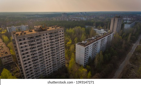 Prypiat, Ukraine, 5th may, 2019. Aerial shot of gloomy Chernobyl multistoried buildings with mutant forest in spring