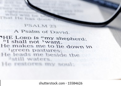 Psalm 23 - The Lord is my shepherd verse with reading glasses partially in frame