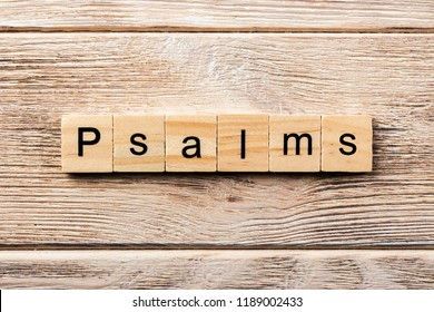 psalms word written on wood block. psalms text on table, concept.