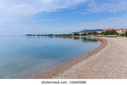 Psani beach in Nafpaktos, Greece - Shutterstock ID 310605086