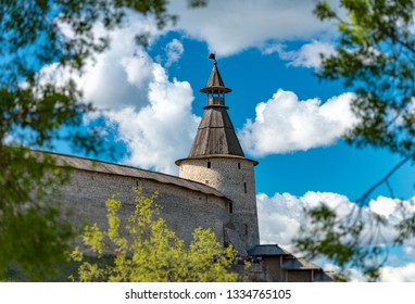 Pskov kremlin tower with blue cloudy sky in background