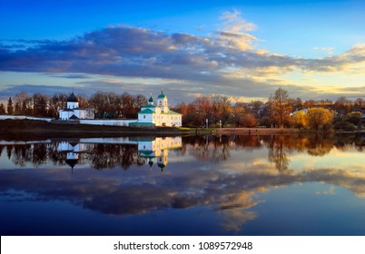 Pskov, Russia. Beautiful scenic view, Mirozhsky Monastery is a 12th-century Russian Orthodox monastery reflected at calm river water at the background of cloudy sunset sky