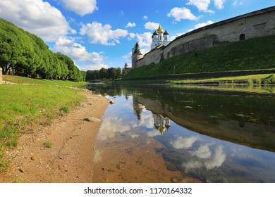 Pskov, Russia, June 22, 2016. Traveling through Russia, a beautiful summer view of the ancient church and the Pskov Kremlin on the river with reflection in the water