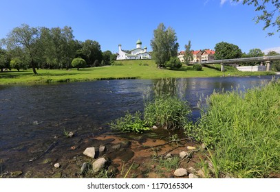Pskov, Russia, June 22, 2016. Traveling through Russia, a beautiful summer view of the ancient church, the city and the green grass by the river