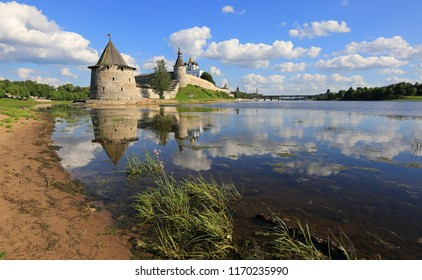 Pskov, Russia, June 22, 2016. A beautiful view of the ancient tower and walls of the Pskov Kremlin with reflection in the water