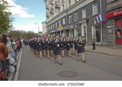 PSKOV, RUSSIA MAY 9, 2015: Girls - members of The Border Guard Service of Russia  are singing at the Victory Parade while marching